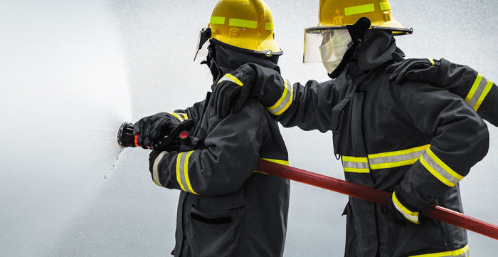 Firefighter at work - wearing fireresisting clothes made form high performance fibers