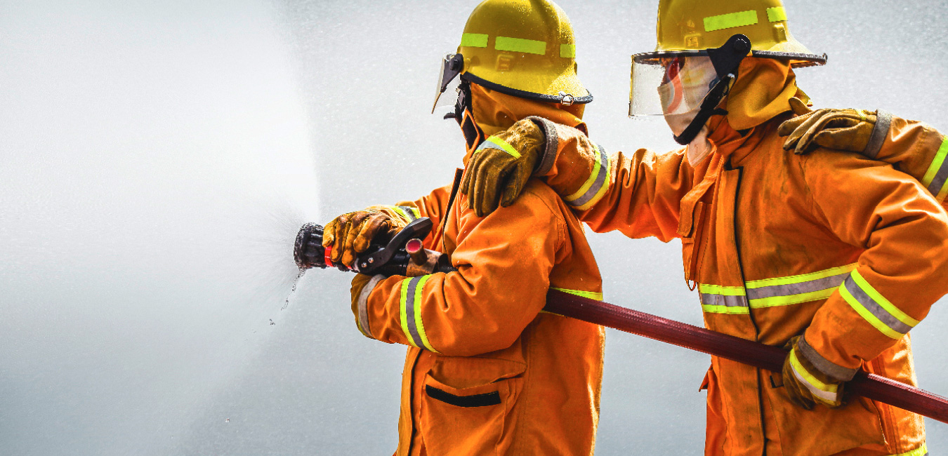 Firefighter ast work - wearing fireresistant clothes made from high performance fibers